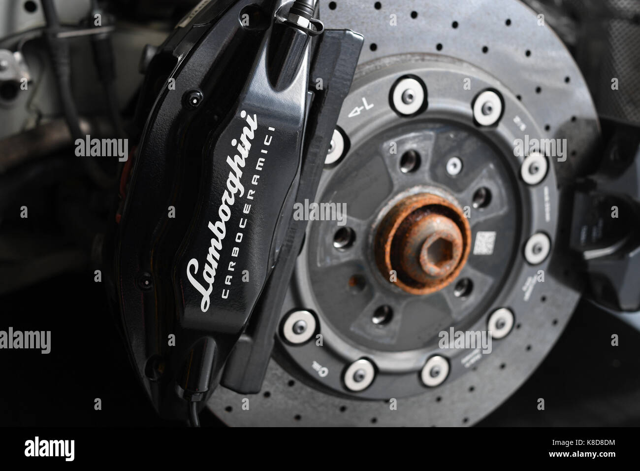 Lamborghini wheel showing Brake calliper and ceramic  disc - Stock Image