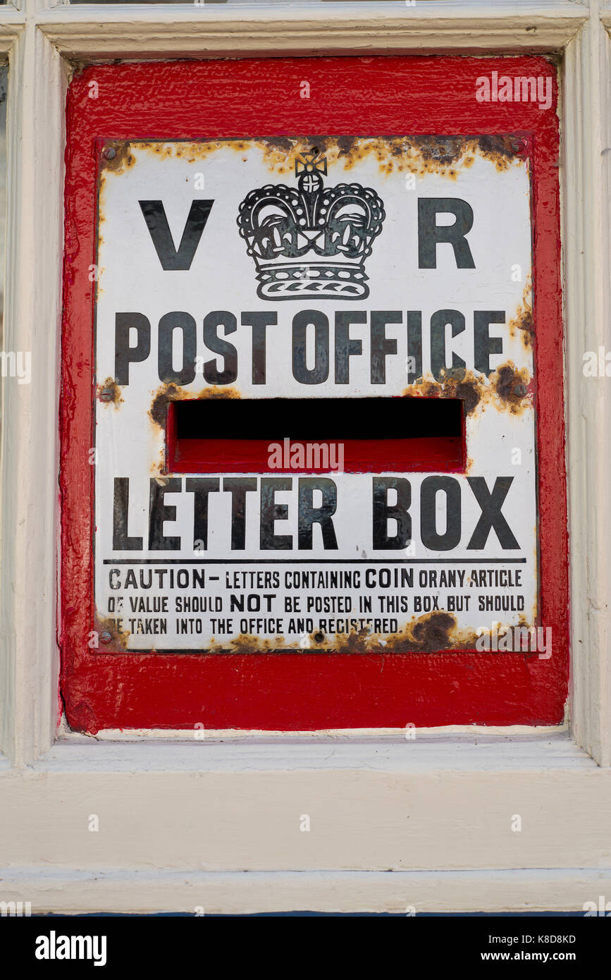 Victorian letter box. Post box with crown and VR initials. - Stock Image