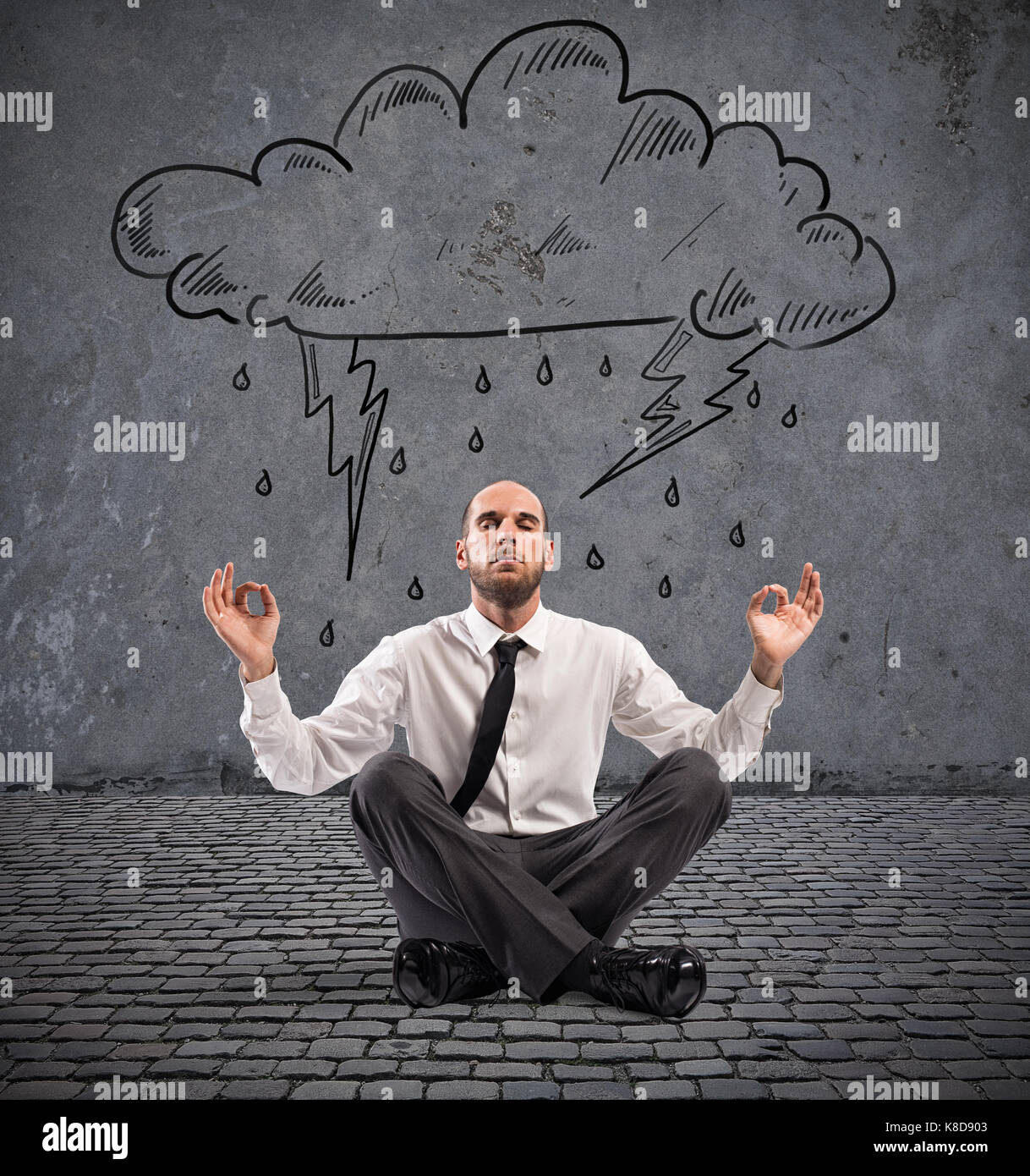 Businessman practice yoga under a rainy cloud - Stock Image