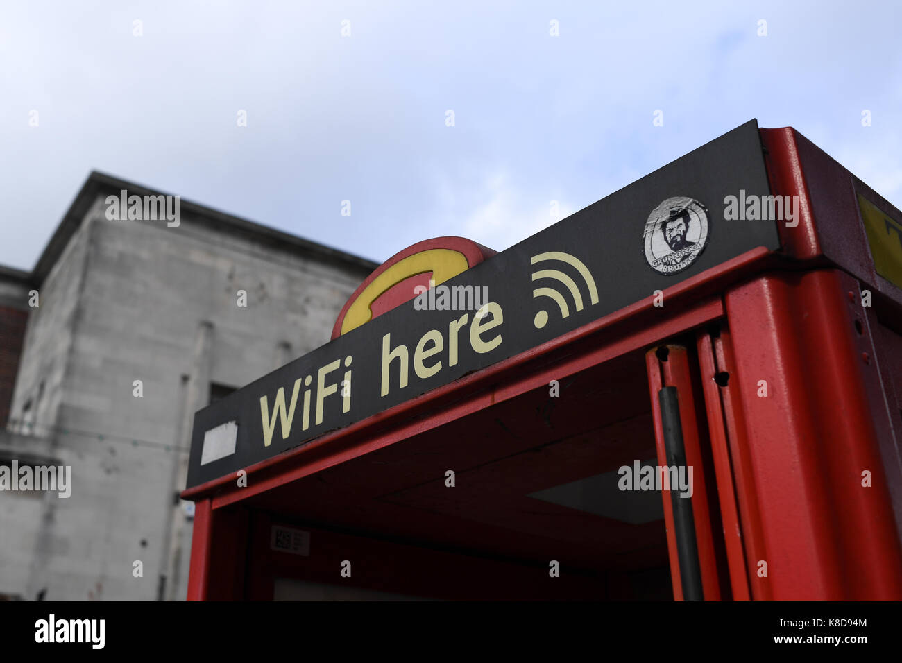 Wifi here sign on public  phone box Stock Photo