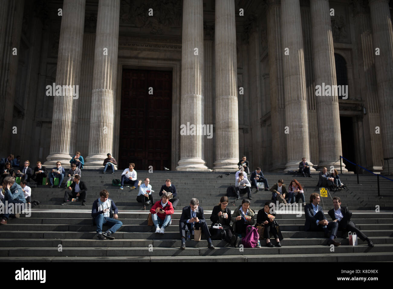 St Paul's Cathedral's steps with people sitting, in London, in England, on 19 September 2017. - Stock Image