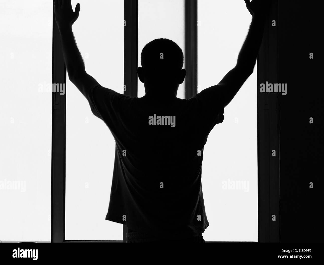 silhouette of a man suffering from depression and mental problems - Stock Image