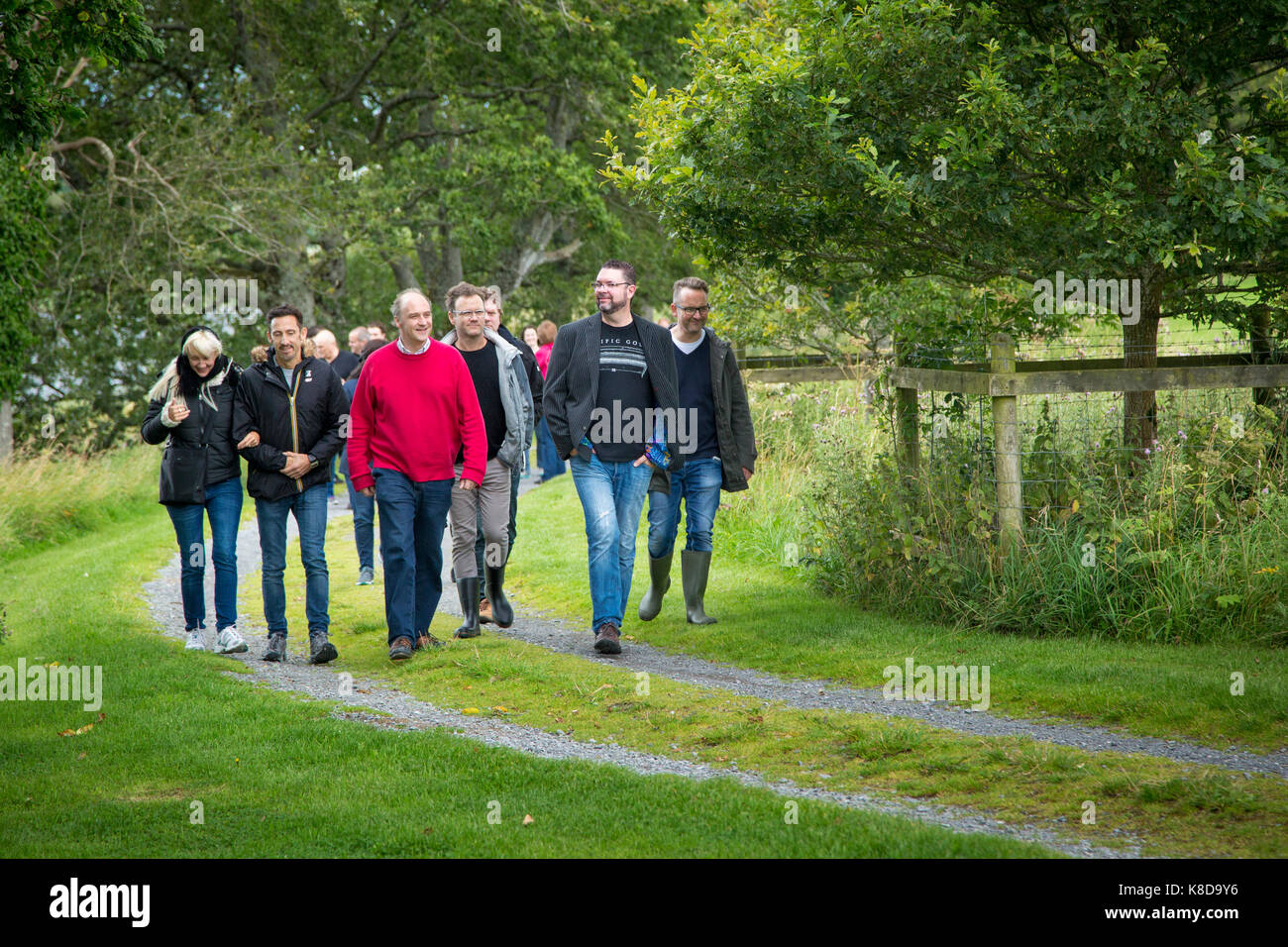 Lord Erne (John John Crichton), 7th Earl of Erne, leads guests on a walking tour of the grounds at Crom Castle, - Stock Image
