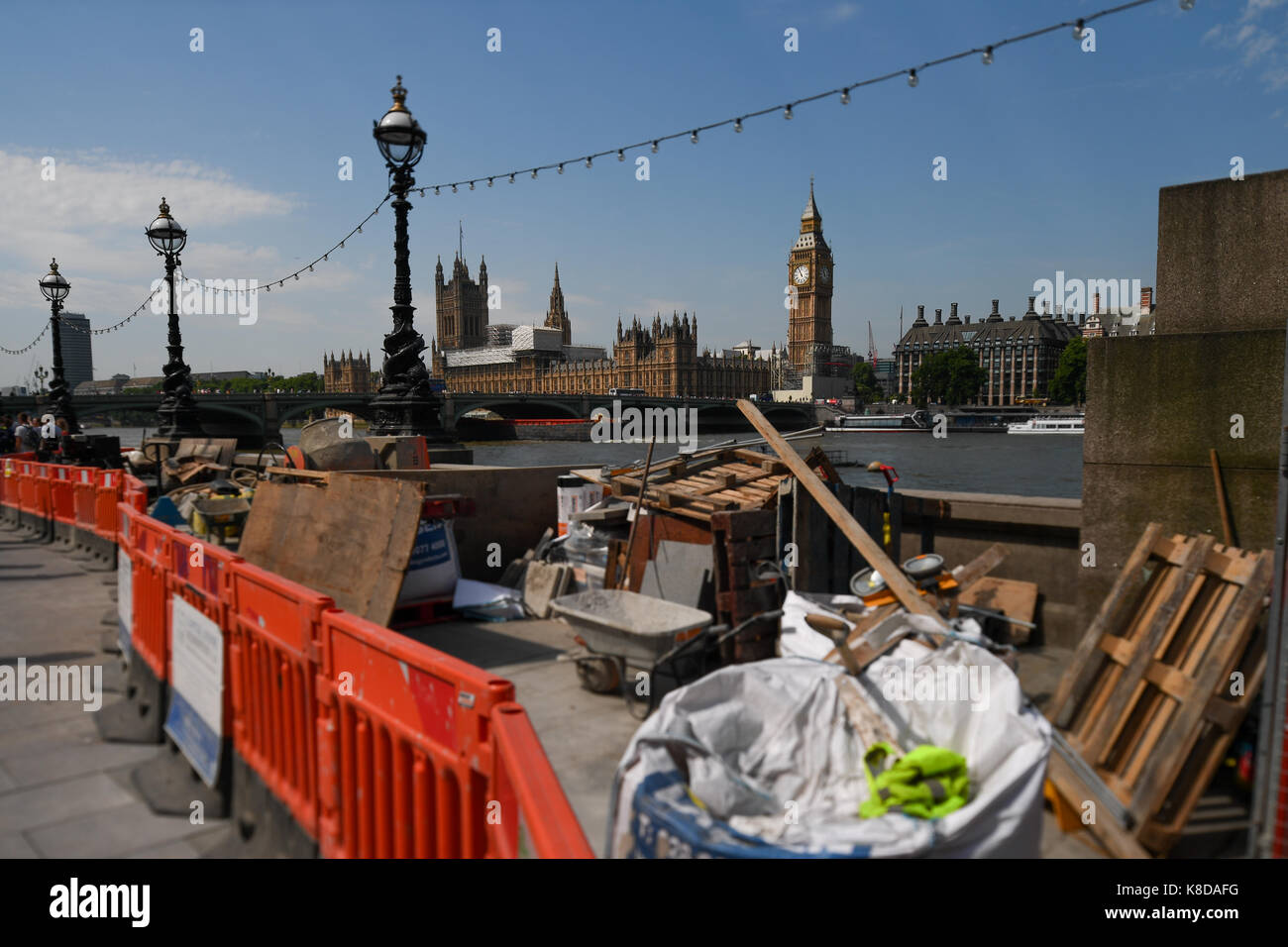 A view of Big Ben ( Elizabeth Tower) in London England with building work and rubbish in the foreground - Stock Image