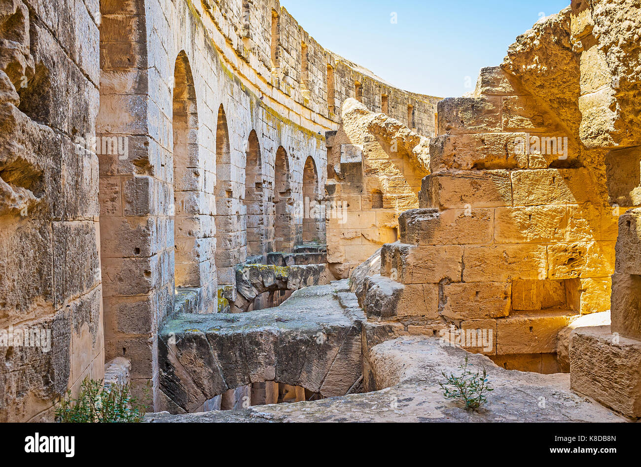 EL DJEM, TUNISIA - SEPTEMBER 1, 2015: The walk along the ruins of portico of El Jem amphitheater, on September 1 - Stock Image