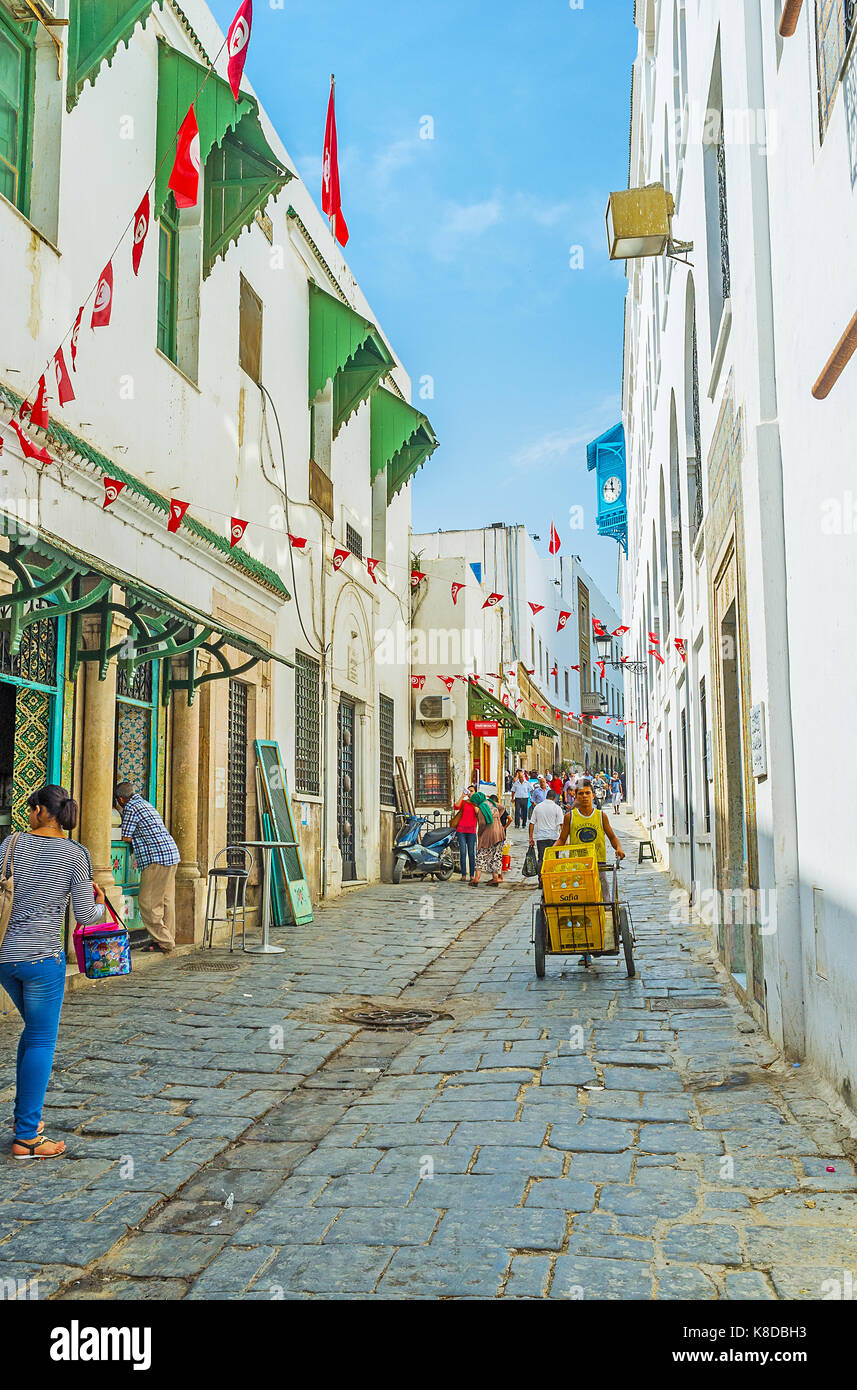 TUNIS, TUNISIA - SEPTEMBER 2, 2015: The old town (Medina) is the perfect place for the daily walk, visit local palaces, - Stock Image
