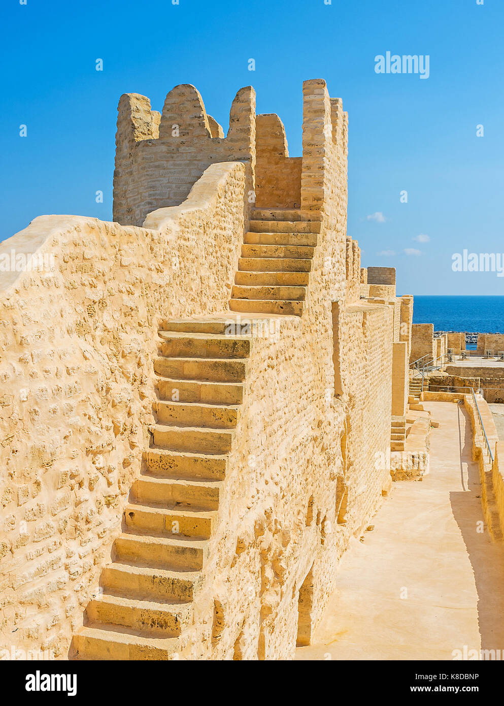 The old stone stairs leads to the preserved tower of Ribat fortress, nawadays this defensive structure serves as - Stock Image