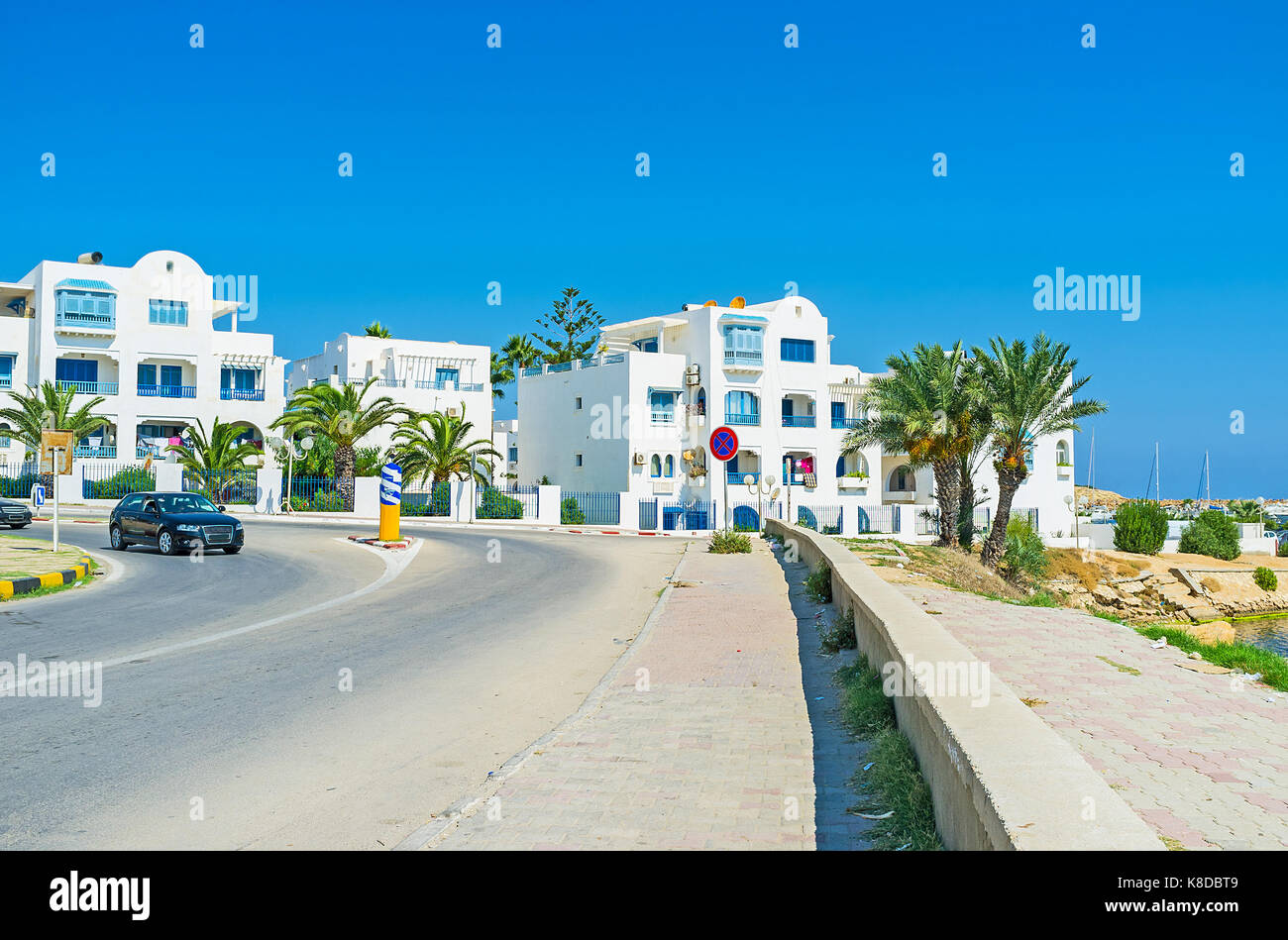 The modern white cottages on the coast of resort, next to the yacht port, Monastir, Tunisia. - Stock Image