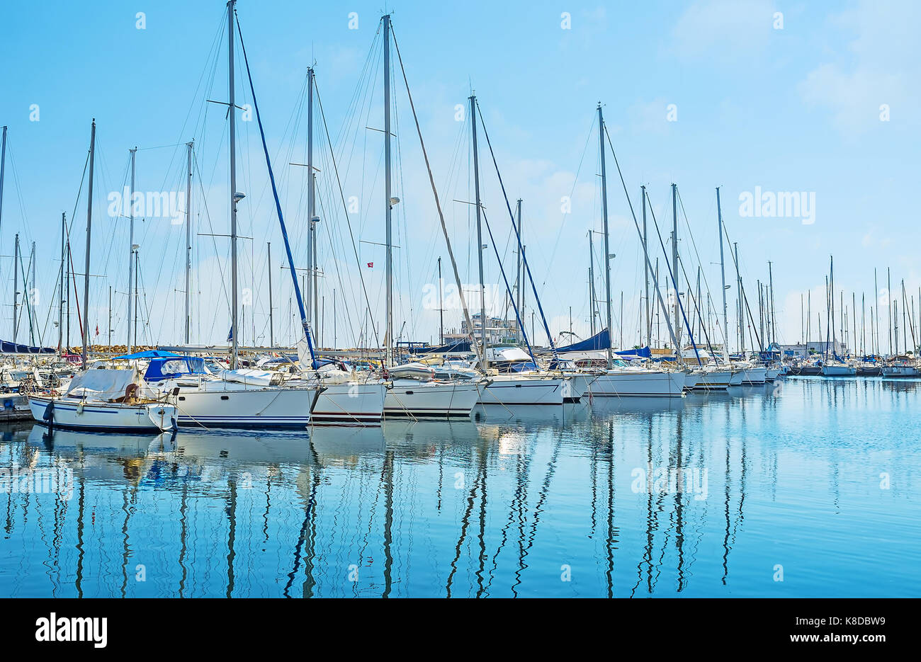 The row of modern white sail yachts, moored in modern marina of resort, Monastir, Tunisia. - Stock Image