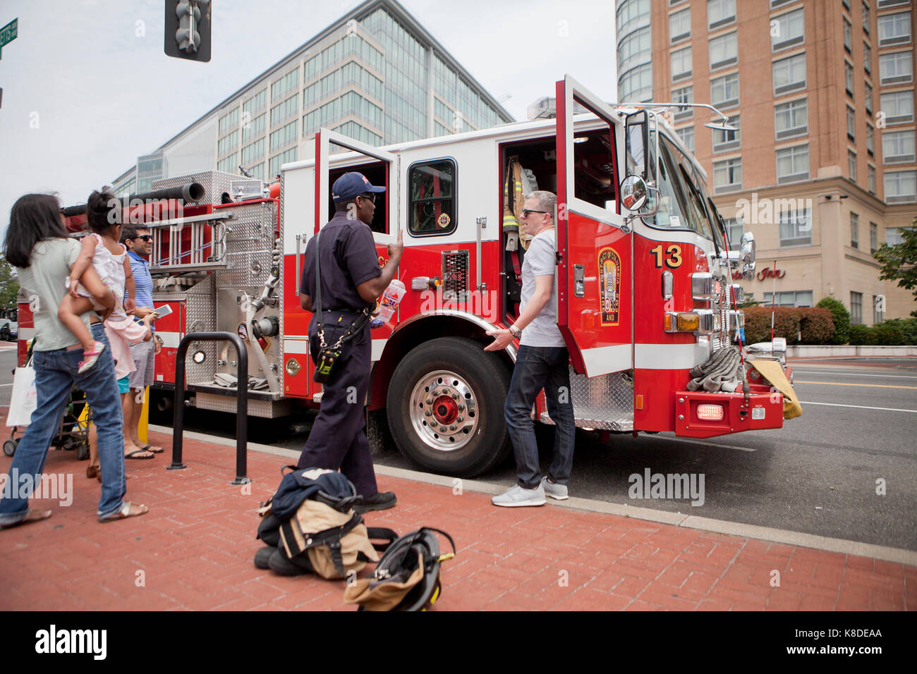 Firefighter showing public fire engine truck - Washington, DC USA - Stock Image