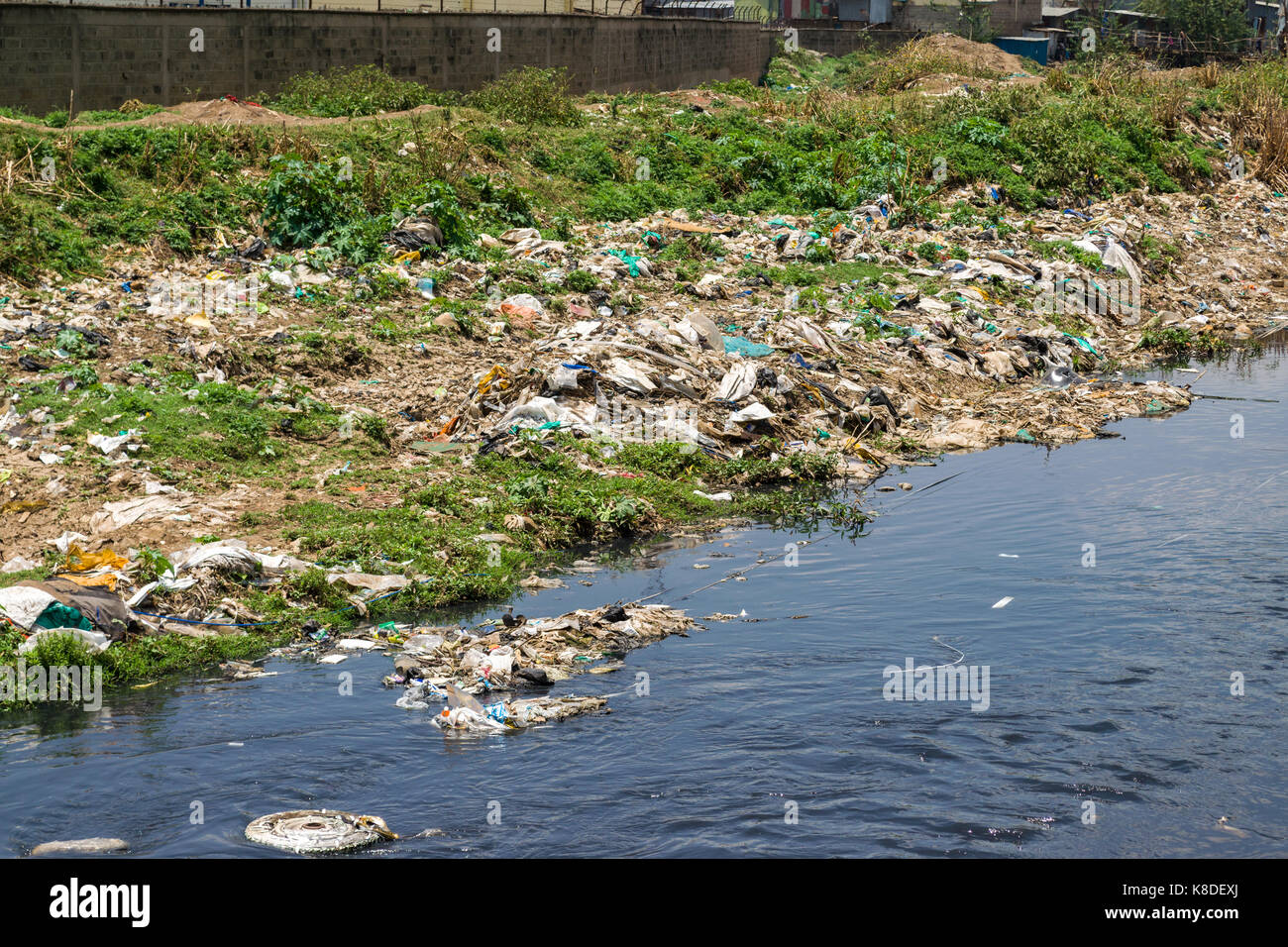 The Ngong river which is polluted with rubbish, plastic waste and garbage, Nairobi, Kenya - Stock Image