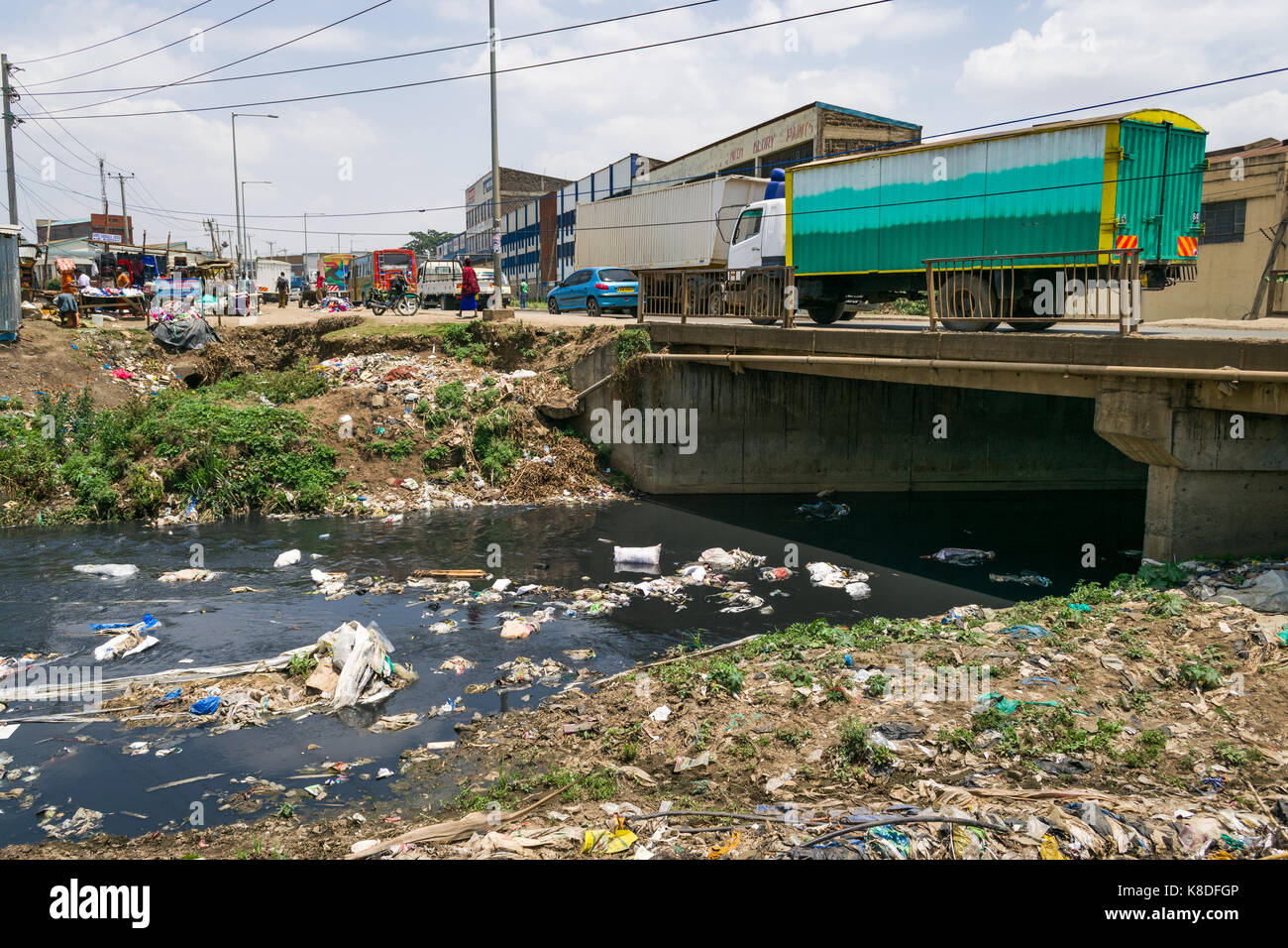 Enterprise road bridge crosses the Ngong river which is polluted with rubbish, plastic waste and garbage, Nairobi, - Stock Image