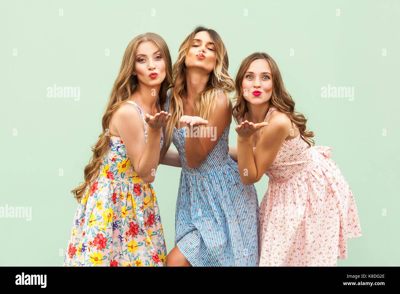 Sending Air Kiss Three Best Friends Posing In Studio Wearing