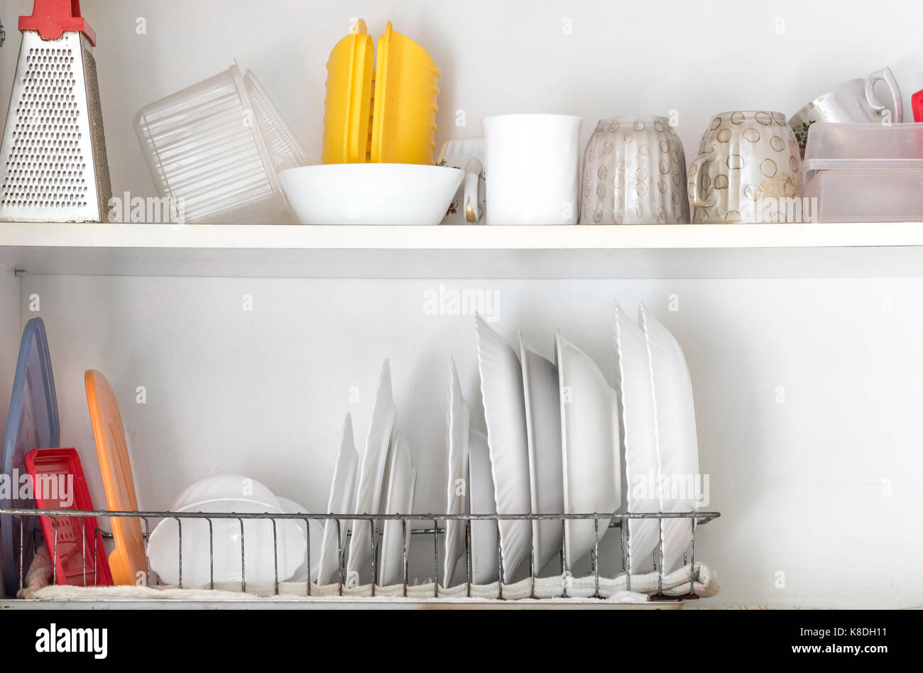 Clean dishes are in the kitchen cupboard Stock Photo: 160109293 - Alamy