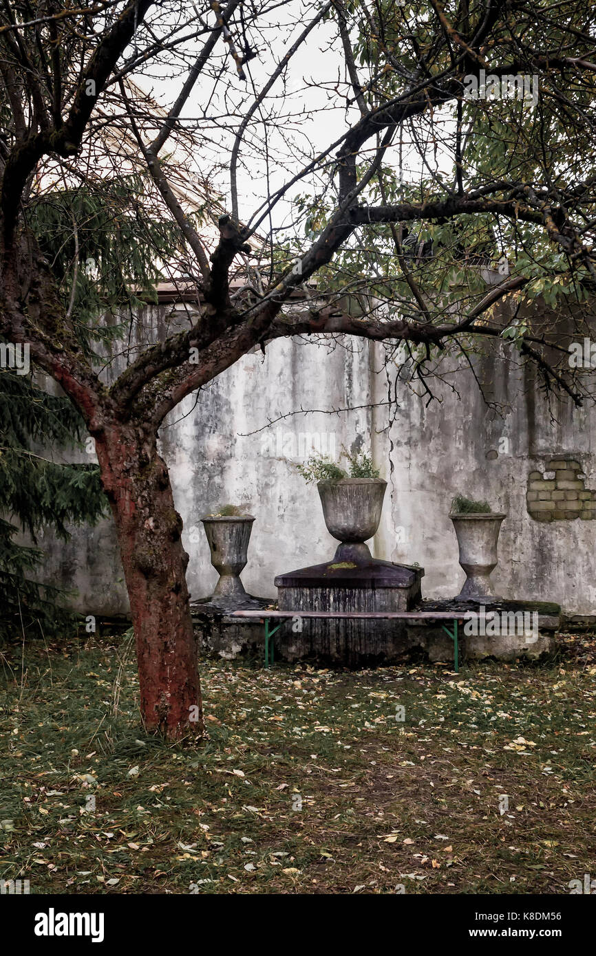 An altar by a tree at the Patarei prison in Tallinn, Estonia. This old fortress was transformed into a prison where - Stock Image