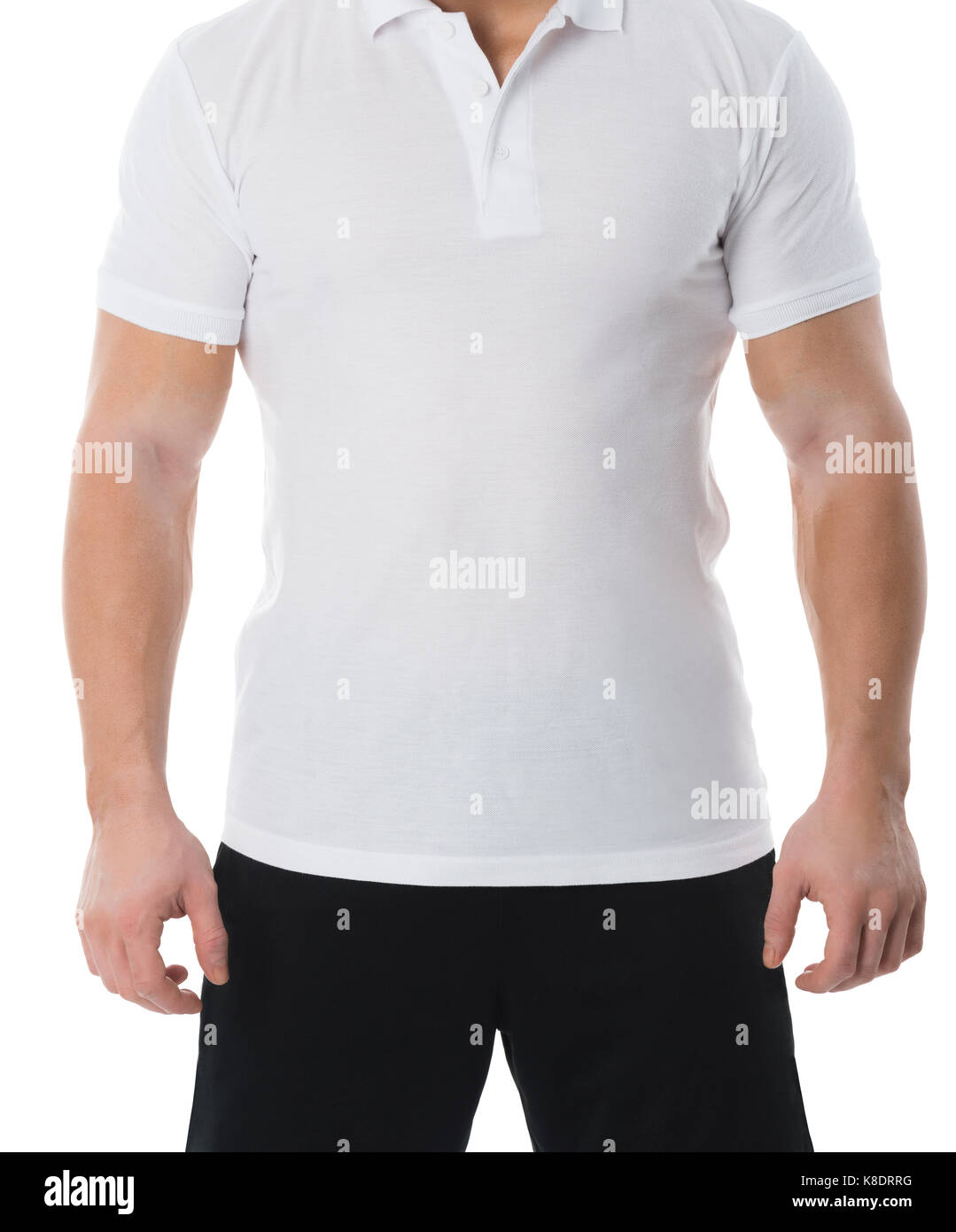 Midsection of man in casuals standing against white background - Stock Image
