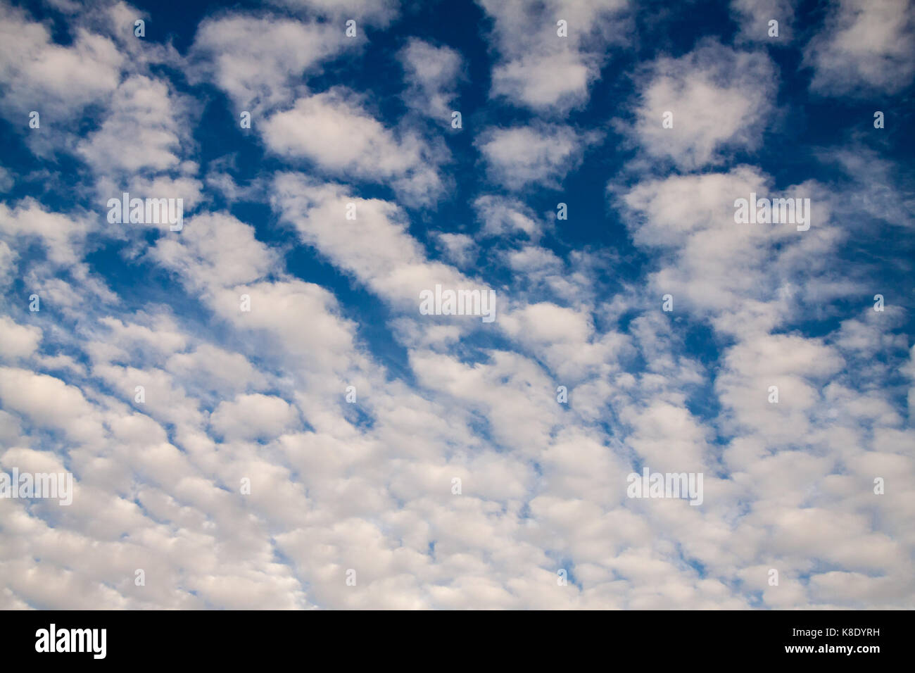 Fluffy Clouds in Bright Blue Sky, Lisbon - Stock Image