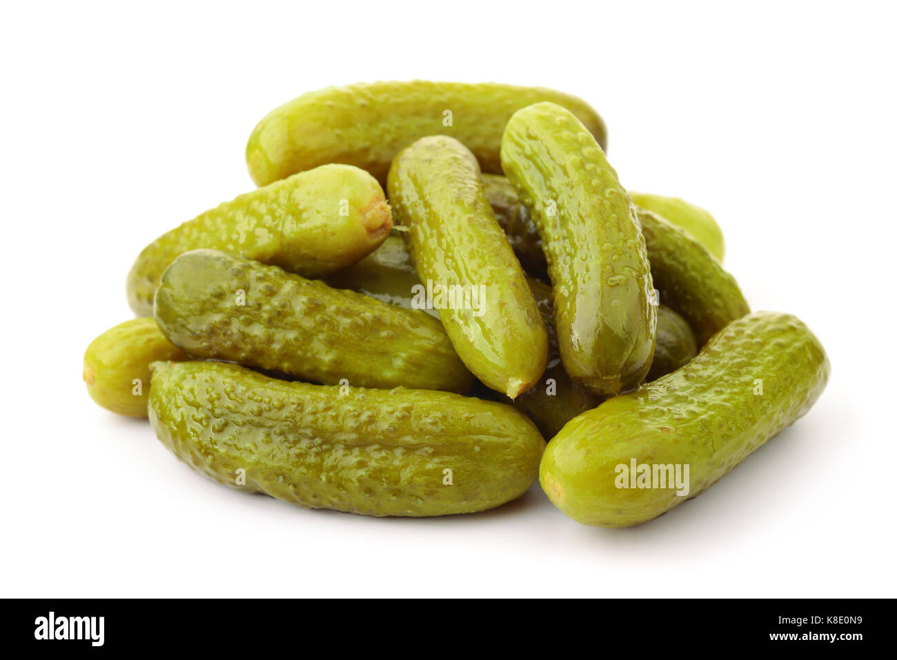Pile of pickled cucumbers isolated on white - Stock Image