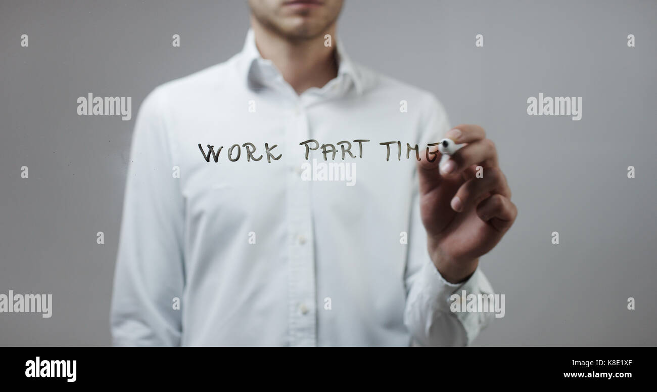 Work part time , Man Writing on Glass - Stock Image