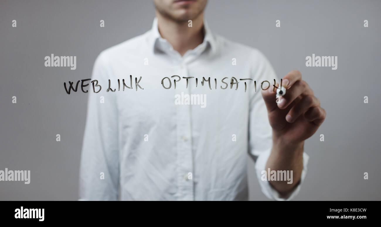 Weblink optimisation , Man Writing on Glass - Stock Image