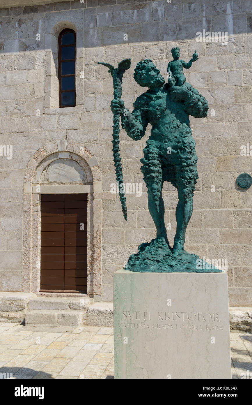Croatia, statue of the Saint Christophoru before the cathedral Maria Ascension in Rab, Kroatien, Statue des St Christophorus - Stock Image