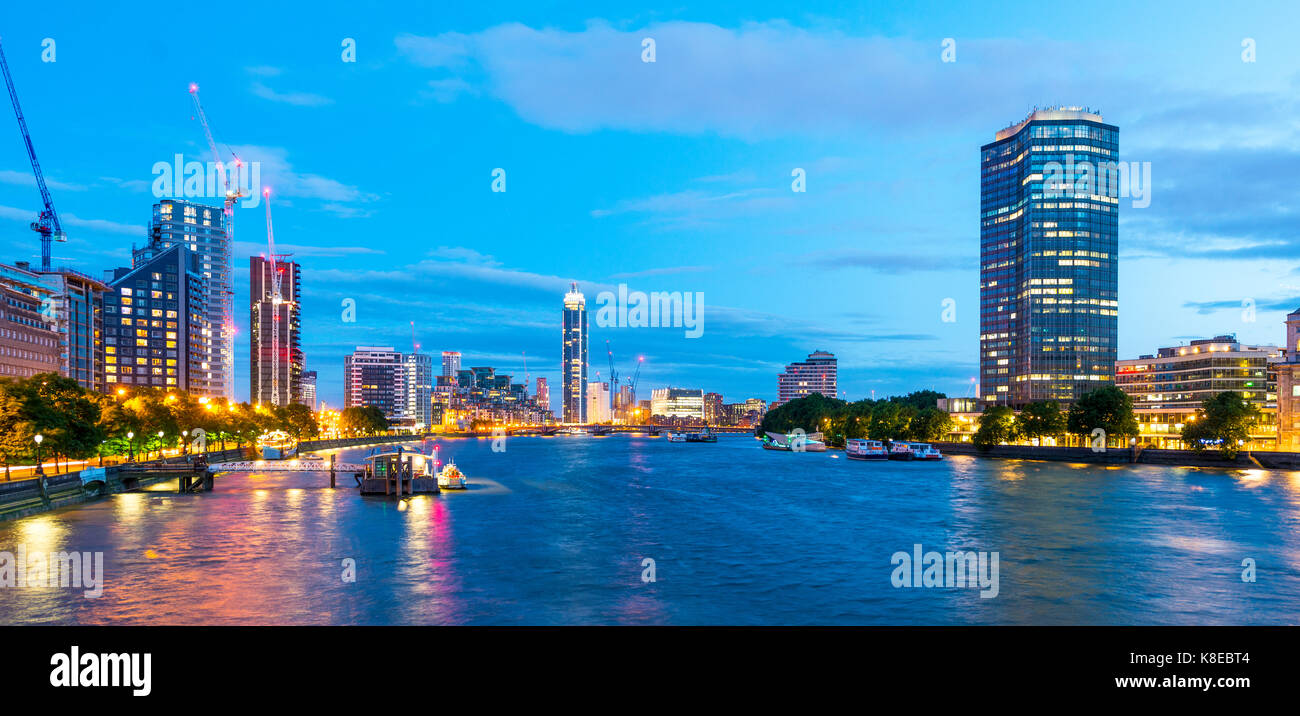 View from Lambeth bridge, skyscrapers next to the River Thames, twilight, districts of Millbank and Vauxhall, London, - Stock Image
