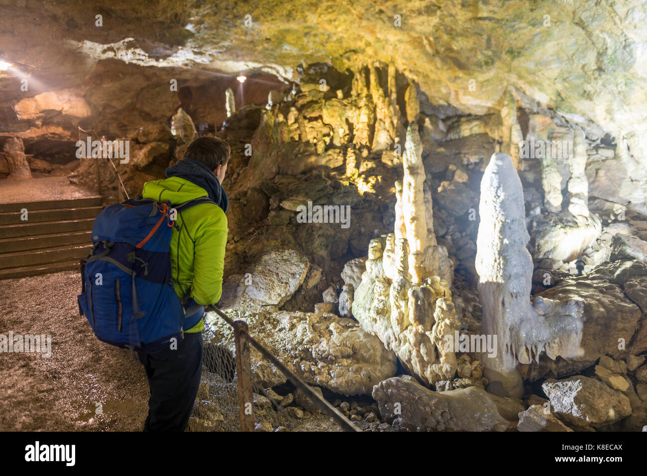 Tourist in Nebula Cave, stalagmites and stalactites, Sonnenbühl, Baden-Württemberg, Germany - Stock Image