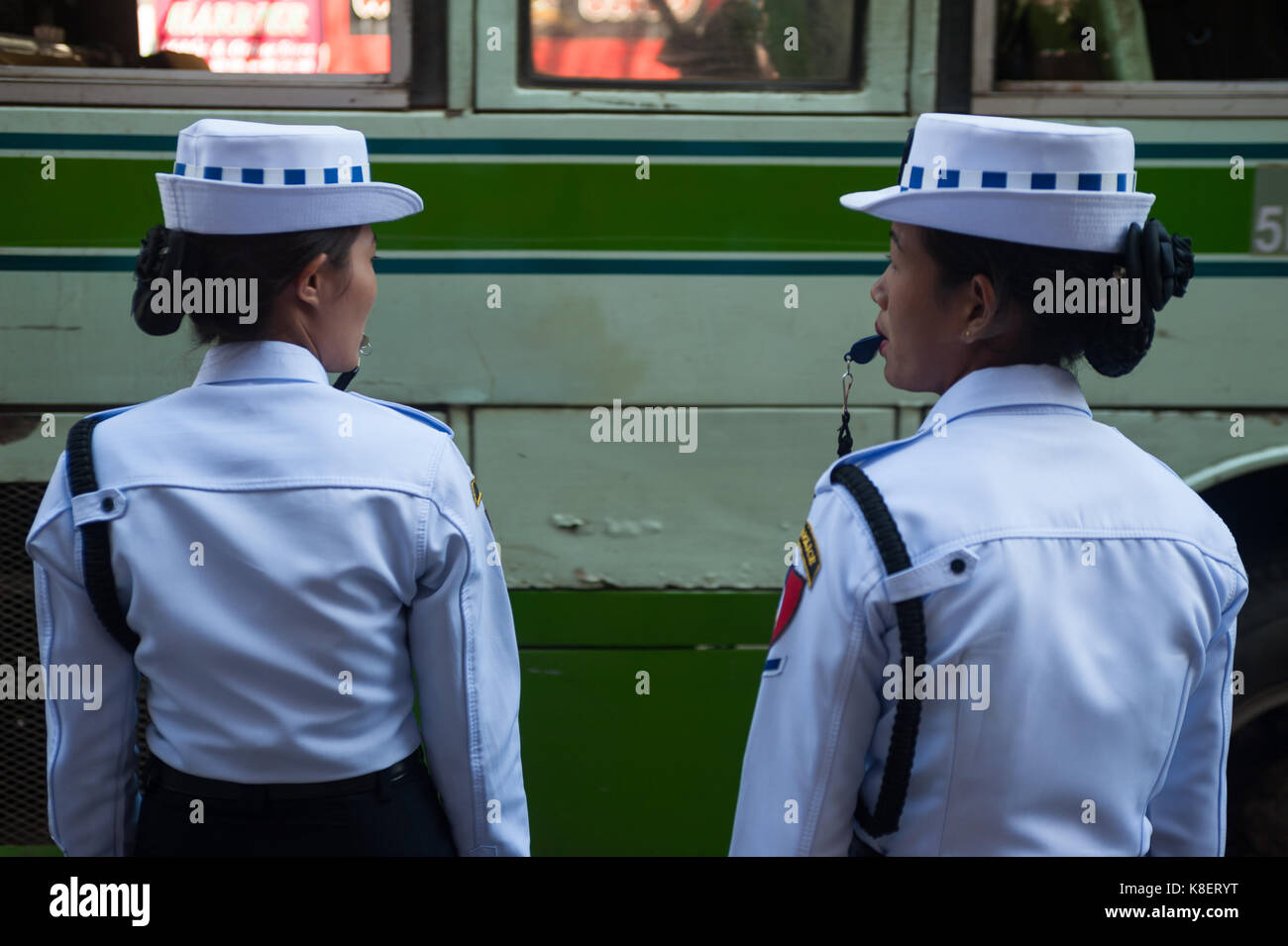 26.01.2017, Yangon, Yangon Region, Republic of the Union of Myanmar, Asia - Two female traffic police officers stand Stock Photo
