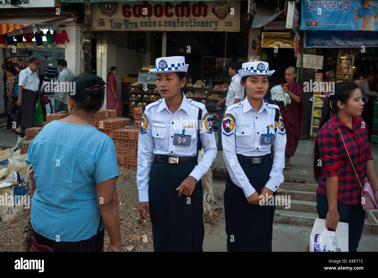 26.01.2017, Yangon, Yangon Region, Republic of the Union of Myanmar, Asia - Two female traffic police officers stand - Stock Image
