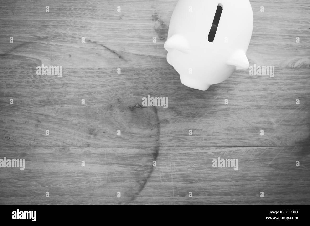 terracotta piggy bank on a wooden background - money saving concept - Stock Image