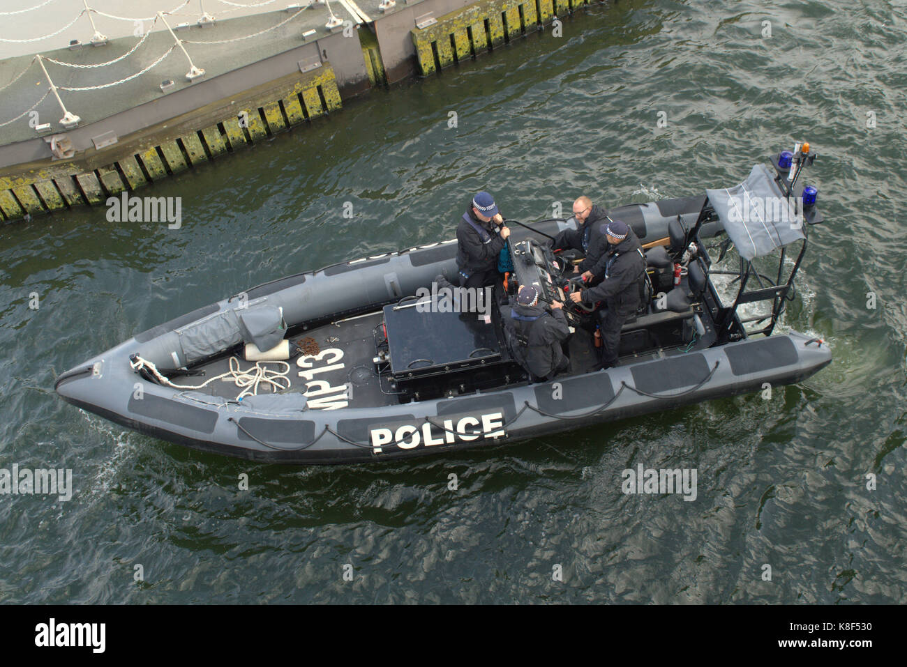 Met Police Marine Policing Unit RIB MP13 patrolling the King George V Lock in Docklands. London  UK - Stock Image