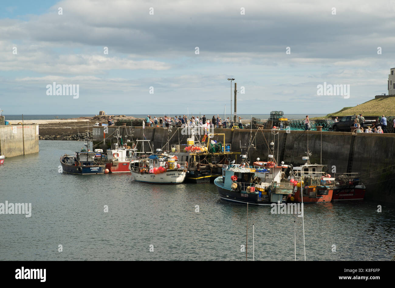 August Bank holiday visitors at Seahouse, Northumberland, England - Stock Image
