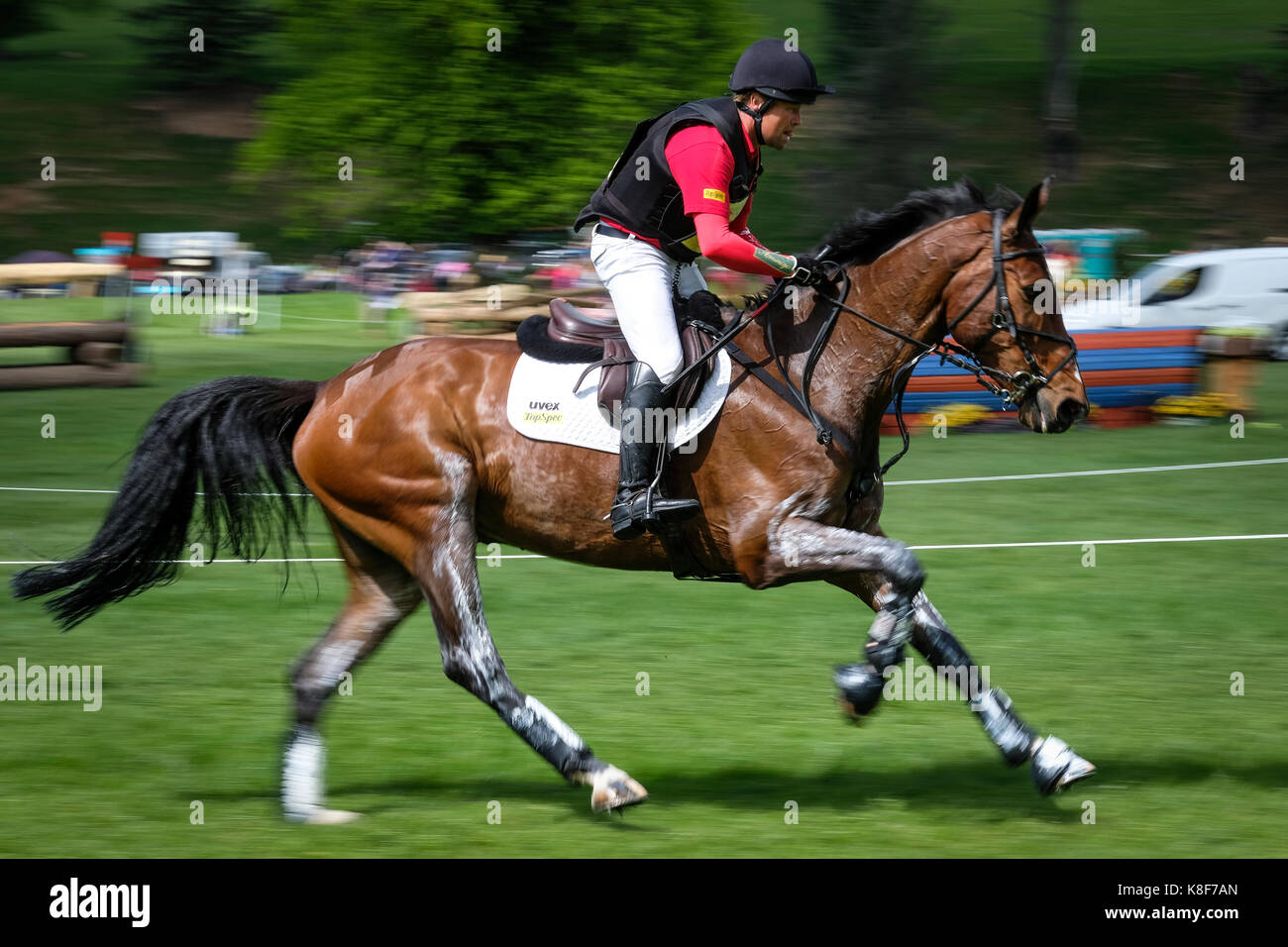 Andrew Heffernan on the cross country course at Chatsworth International Horse Trials - Stock Image