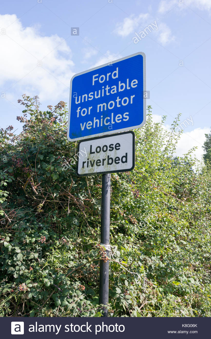 Sign which reads 'Ford unsuitable for motor vehicles - Loose Riverbed' - Stock Image