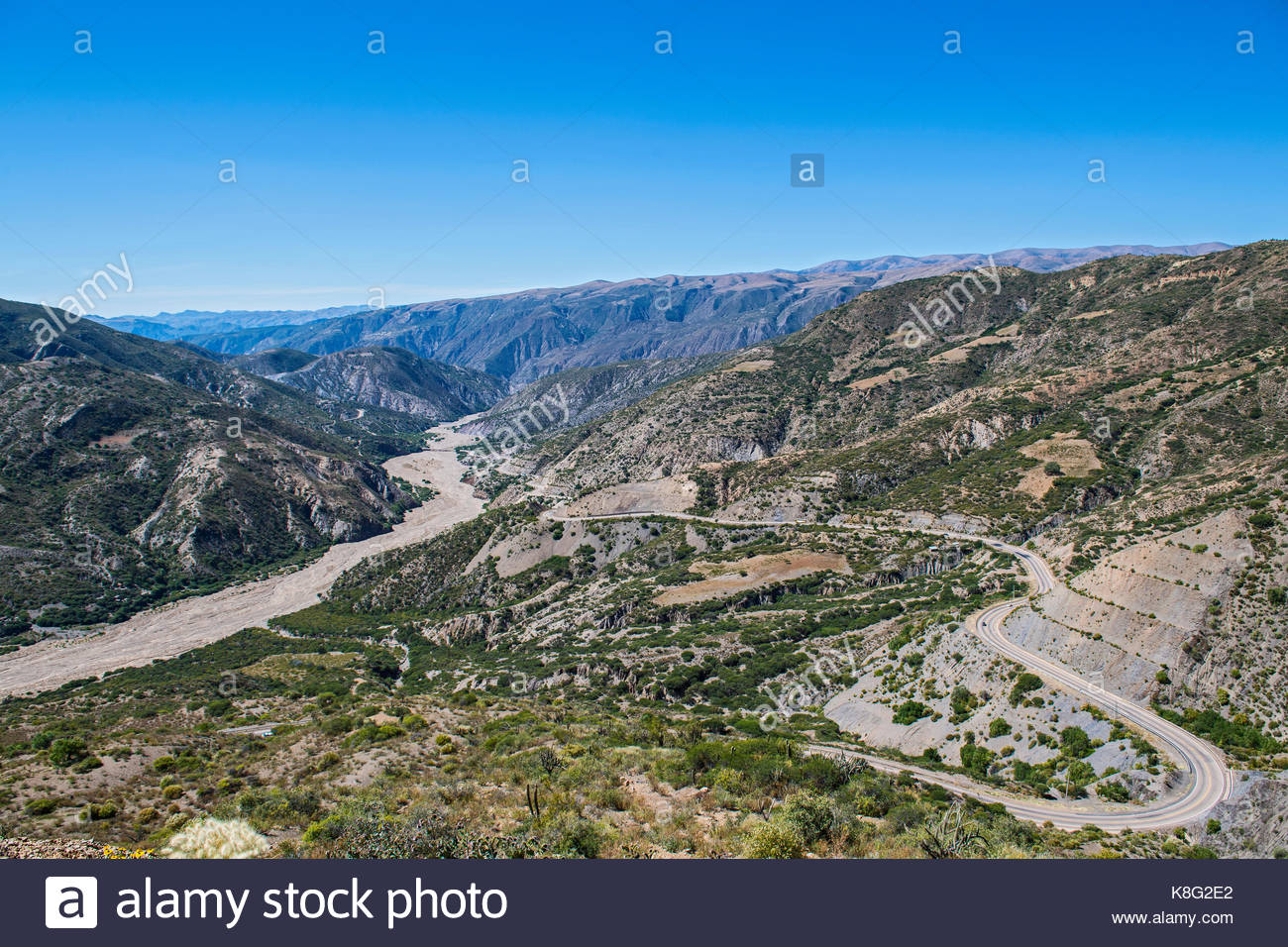 Elevated landscape view of winding road between Potosi and Sucre, Bolivia - Stock Image
