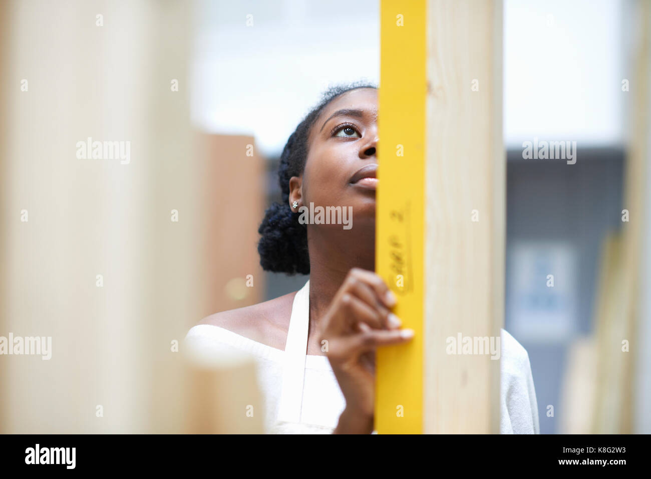 Student learning how to do building work - Stock Image