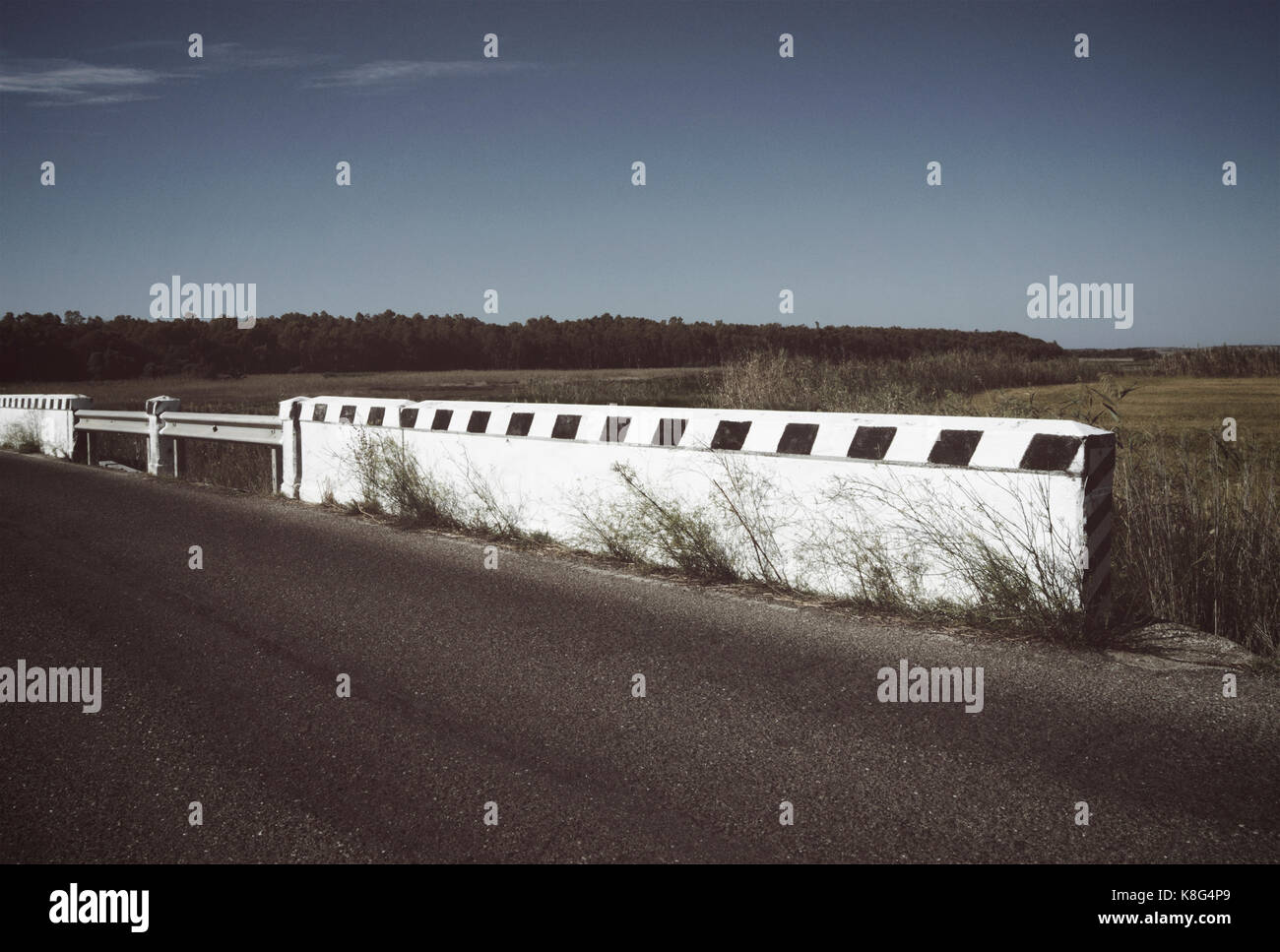 country road and roadside wall - Stock Image