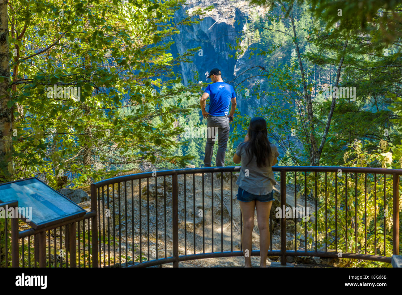 Man over the fence in North Cascades National Park in Northwest Washington State - Stock Image