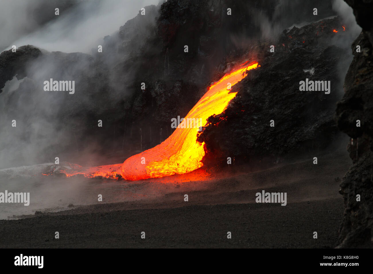 Lava flow at night in Hawaii - Stock Image