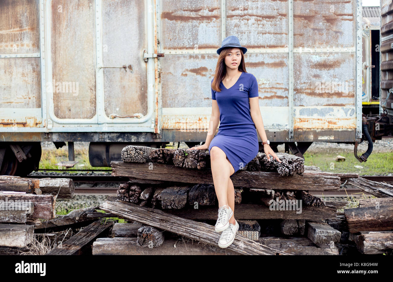 asian thai lady model post action tourism hold old train in dark clound concept - Stock Image