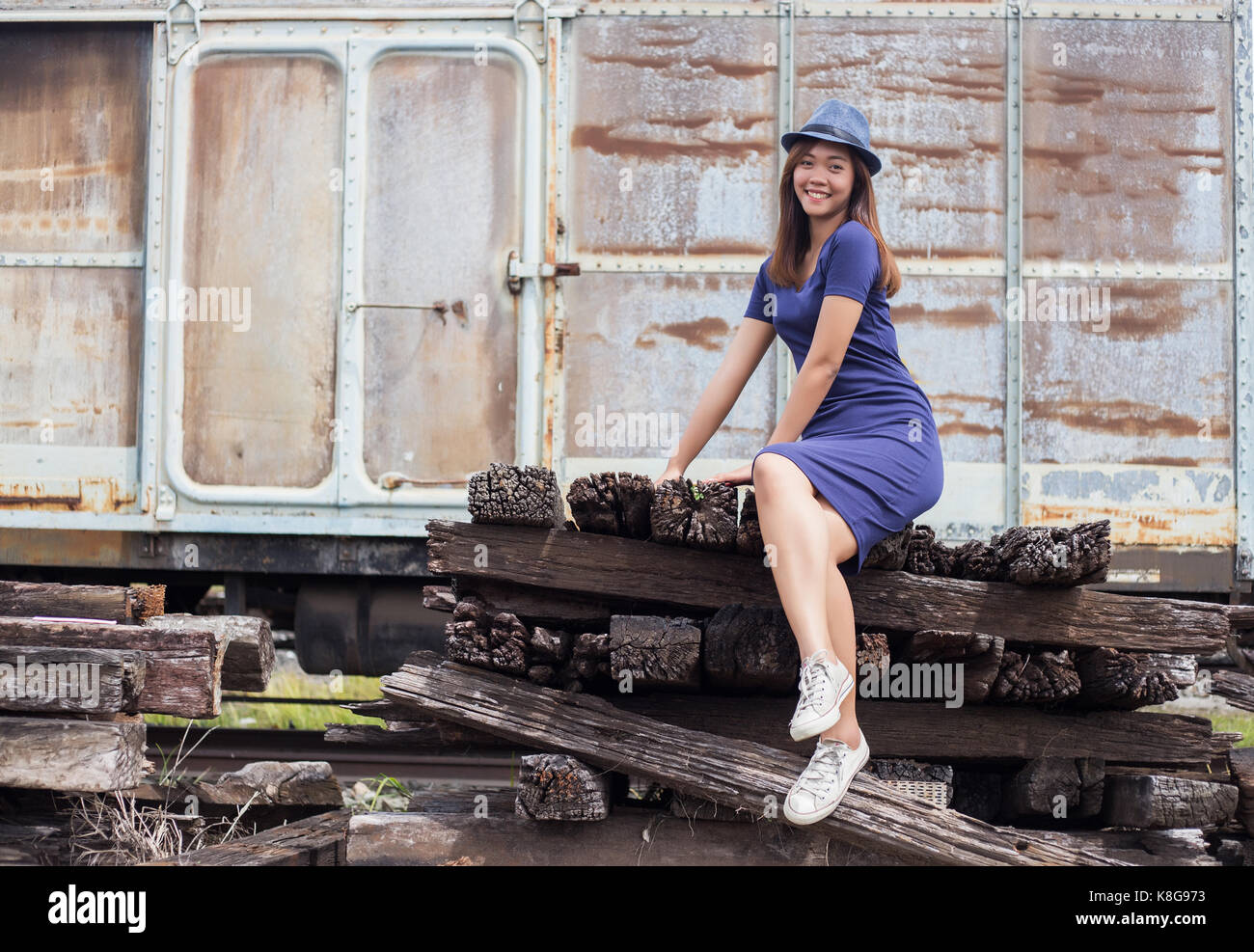 asian thai lady model post action tourism old train in dark clound concept - Stock Image