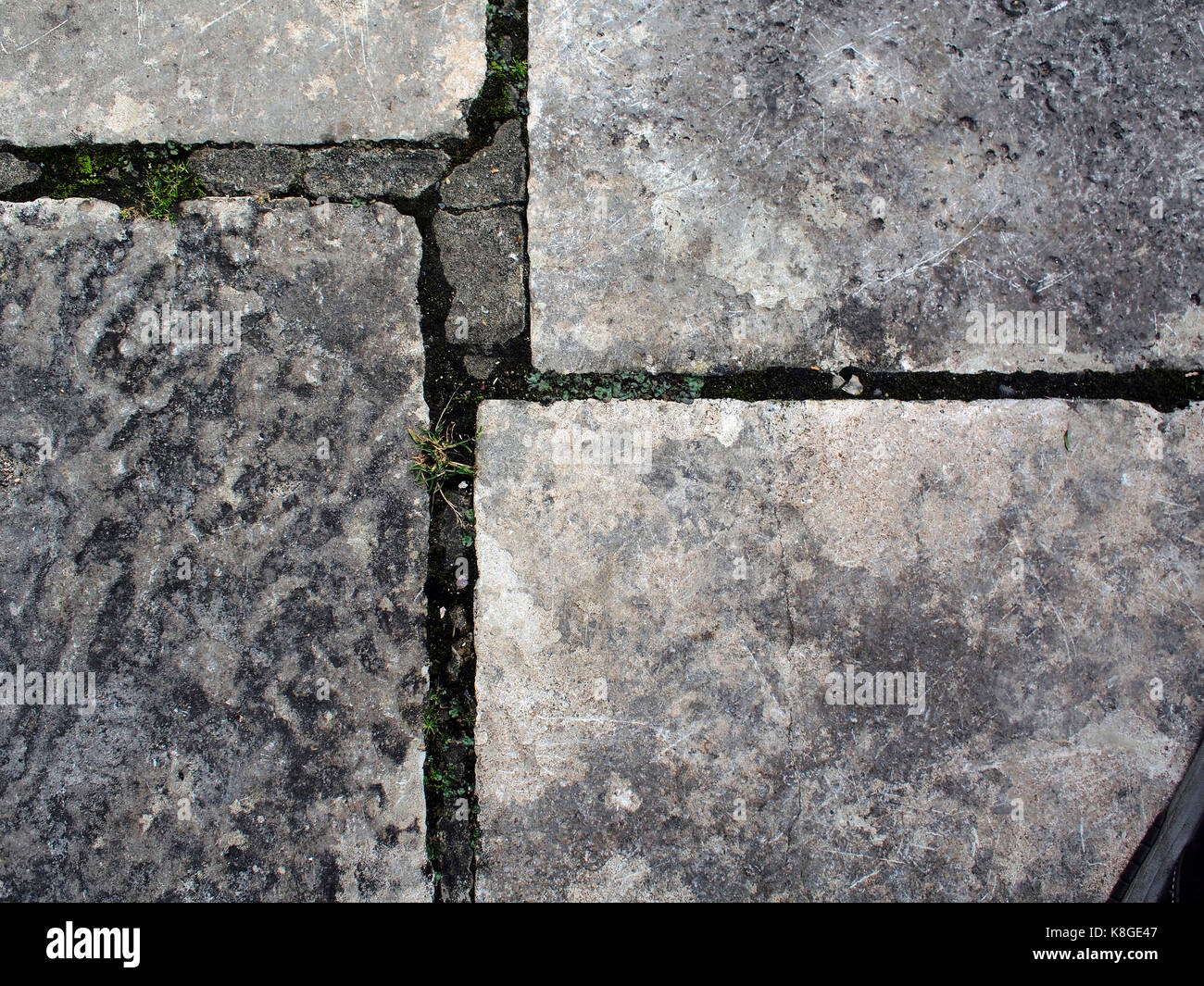 Detail of stone paving slabs with weathered joints. Stock Photo