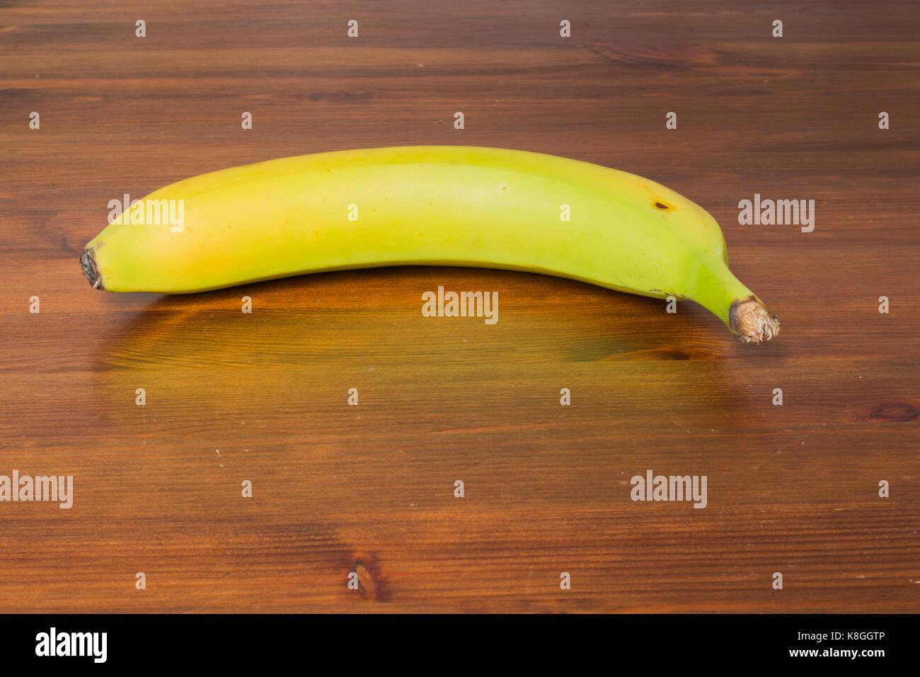 Banana On Table Yellow Green Banana On A Wooden Table.