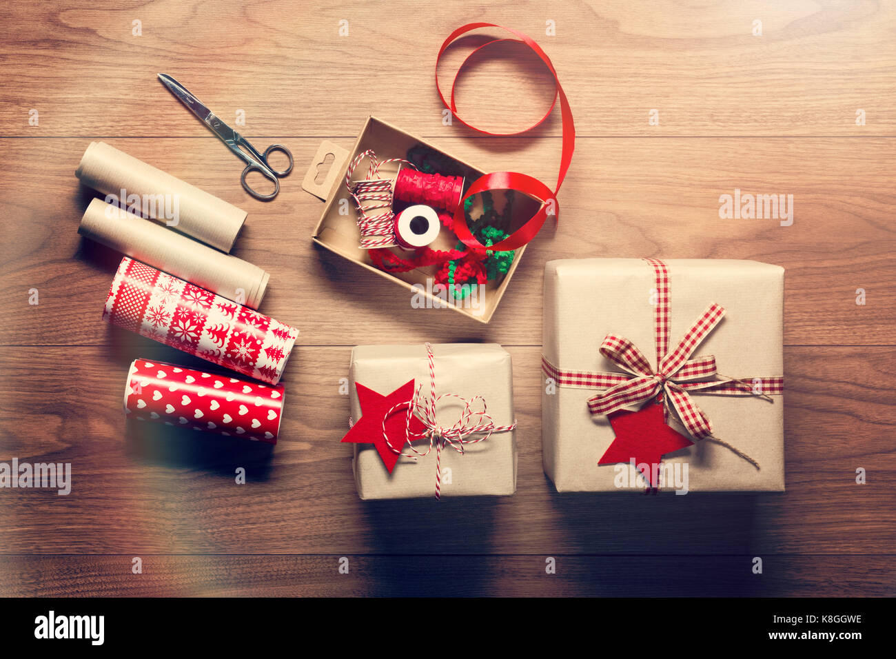 Beautiful retro christmas gift wrapping, xmas concept, DIY desk view from above background - Stock Image