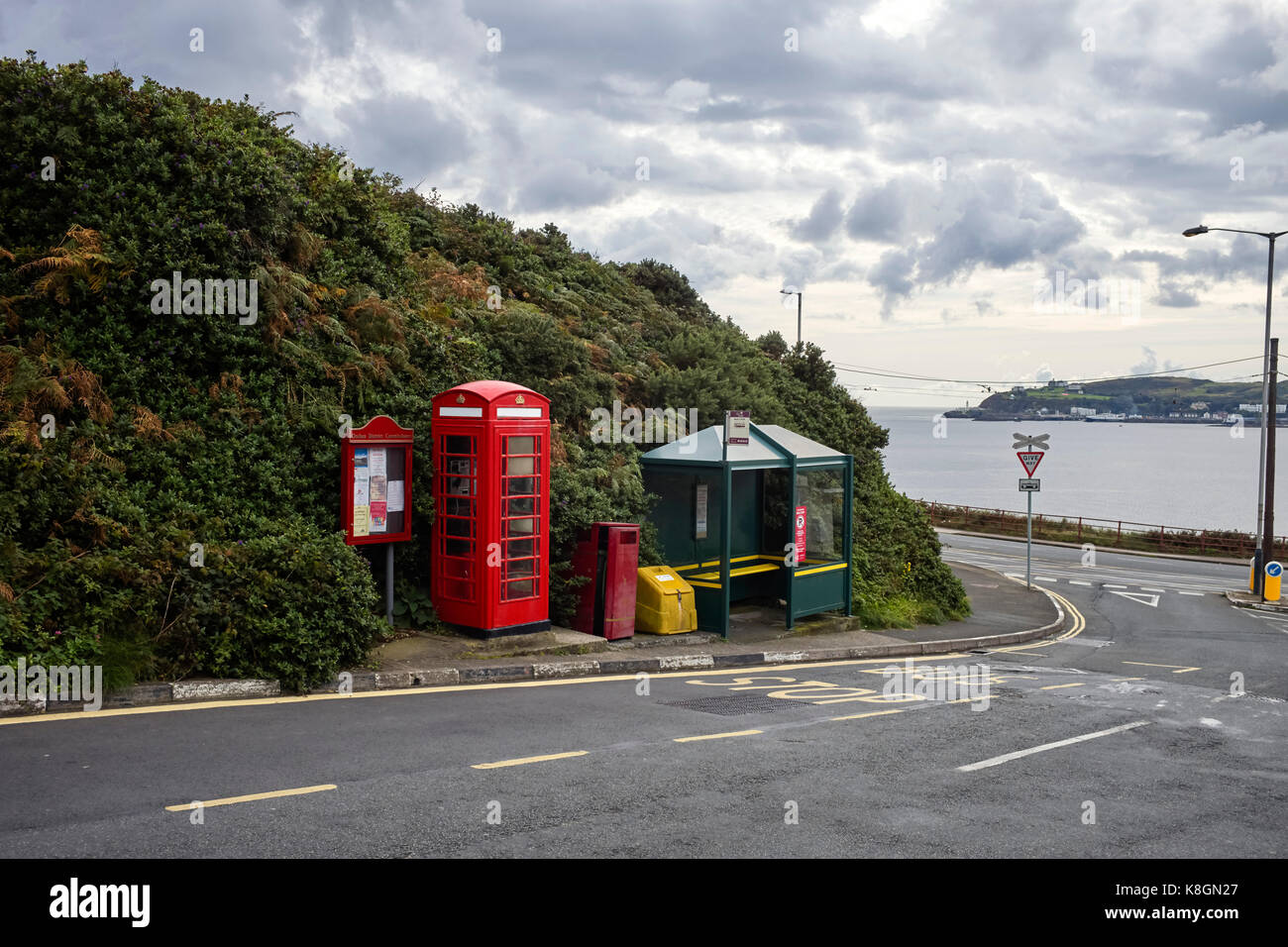 Red phone box and bus stop at Port Jack, Onchan, Isle of Man - Stock Image