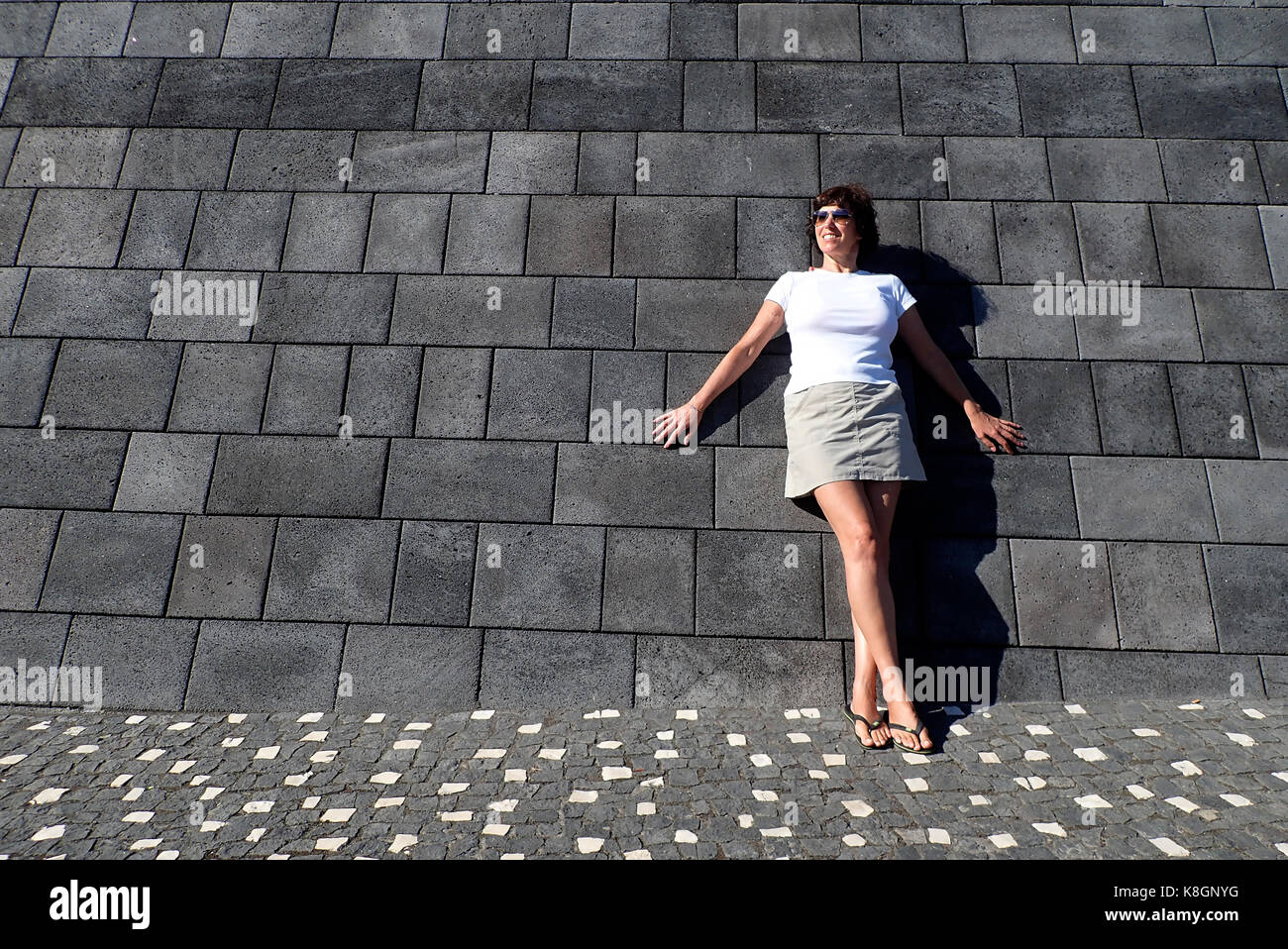 Woman Basalt Wall Horta City Faial Island Azores Portugal Europe - Stock Image