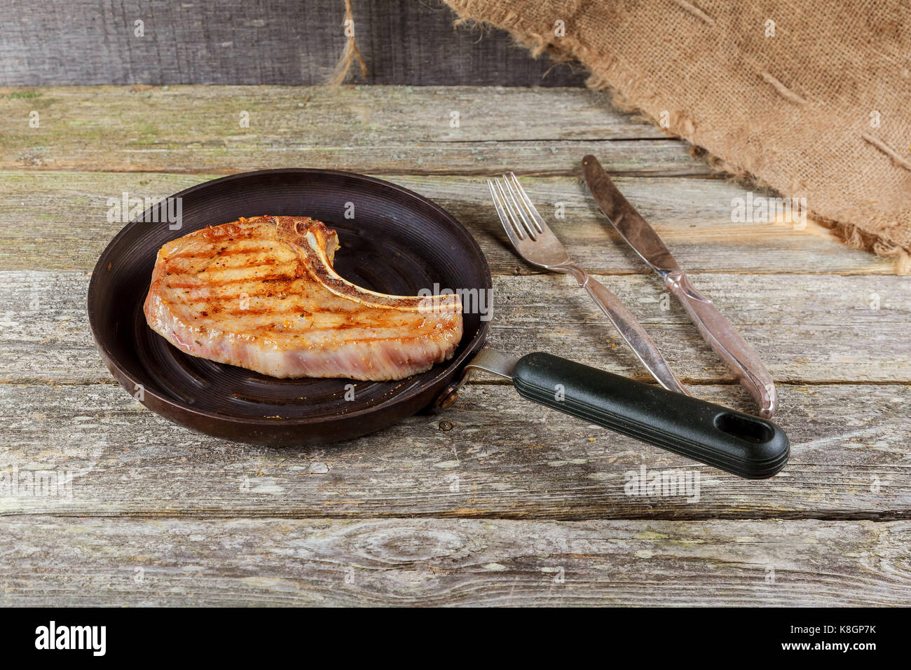 Grilled meat and vegetables on rustic wooden table. savory sauces and salt served with grilled steak on a rustic Stock Photo