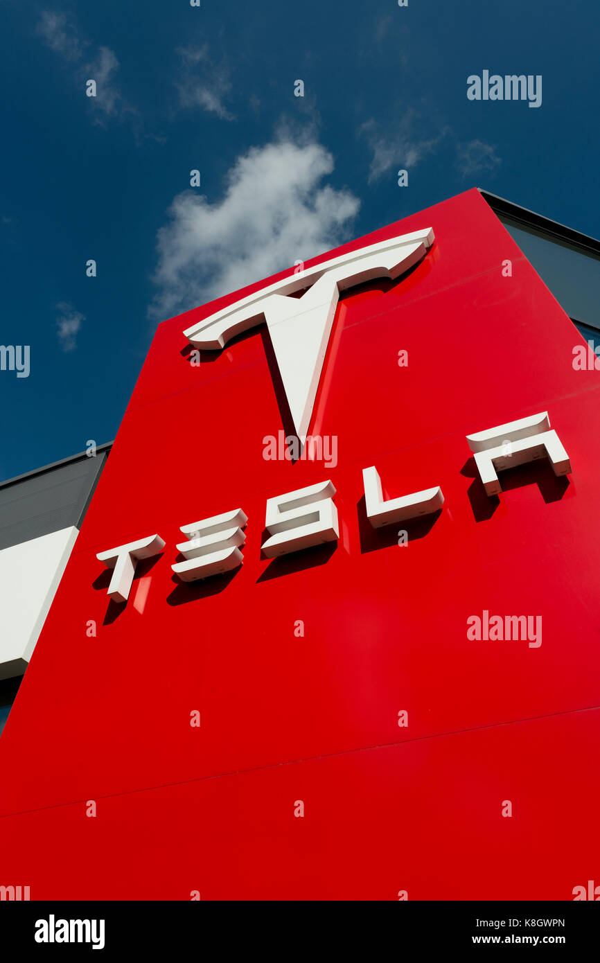 The signage for a Tesla car showroom located in Heaton Chapel and listed as South Manchester, in the UK (Editorial - Stock Image