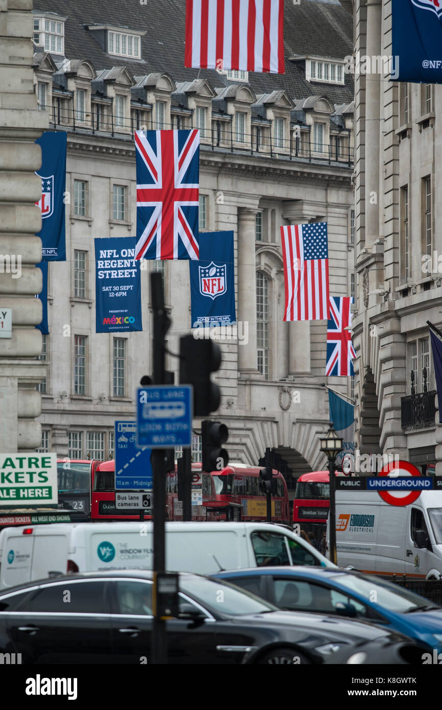 NFL on Regent Street hanging banners above traffic in central London. - Stock Image