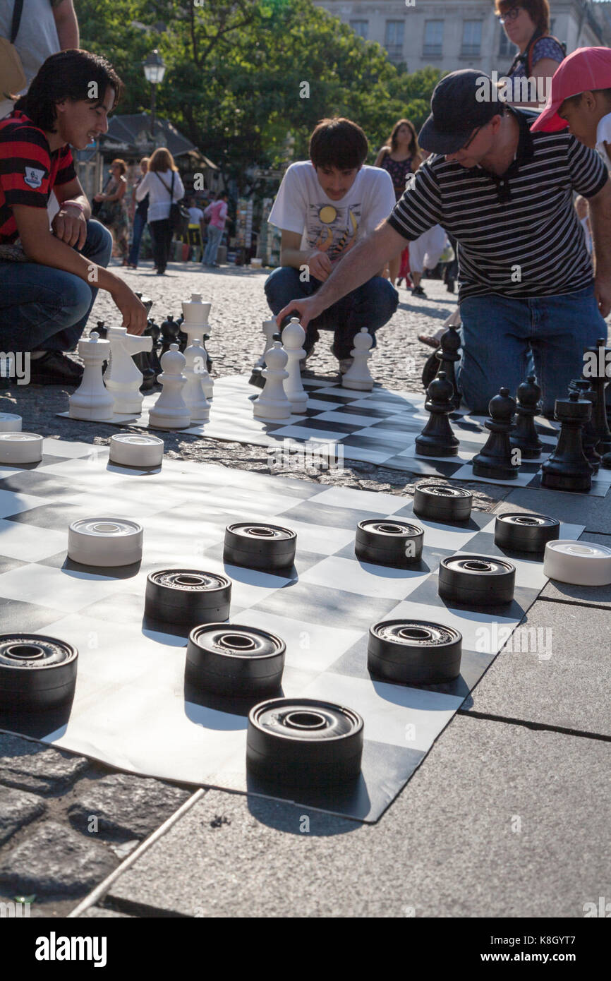 France, Paris, street draughts and chess being played at the Pompidou Beaubourg Centre. - Stock Image